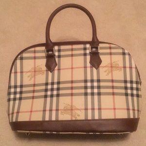 Burberry's Signature Equestrian Hand Bag